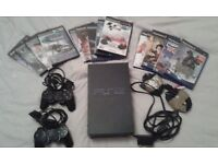 PS2 with 13 games - excellent condition.
