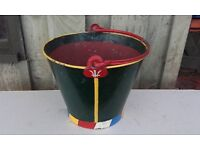 Old painted metal bucket. Probably from canal barge or similar. Colourful decorative item.