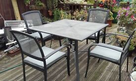 black & silver metal table & chairs with cushions