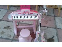 girls guitar and piano and pink stool