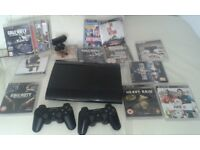 Playstaion 3 super slim 16 Games 2 dualshock 3 controllers .and camera