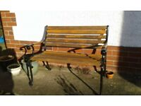 Antique quality refurbished cast iron and hardwood garden bench seat