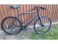 Carrera gryphon sport disc hybrid bike