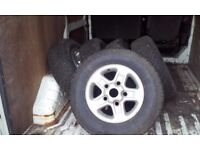Set of five land Rover alloy wheels and tyres