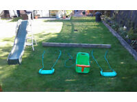 Childrens swings, slide and supporting beam