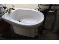White bidet, gold plated taps & fittings