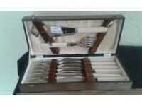 Canteen of fish cutlery with servers in wooden box
