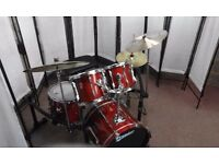 Retired drum teacher has a Premier XPK fusion drum kit in cherry wood for sale.