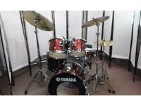 Retired drum teacher has a Yamaha Fusion drum kit in red glitter for sale