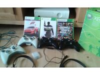 Xbox 360 console, 3 games, 4 controllers, wireless and hard drive