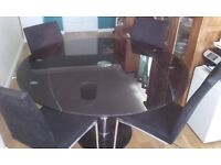 REDUCED NEED THIS TO GO, moving: Smoked glass extendable table ONLY, not chairs