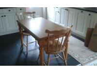 pine kitchen table and two chairs - table measurements are 26 inches by 44 inches