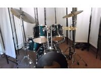 Retired drum teacher has a Pearl Export drum kit for sale