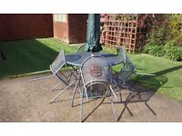 Metal garden table four chairs and parasol