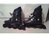 black roller blades, size 8,