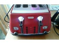 Delonghi 4 slice toaster in red.