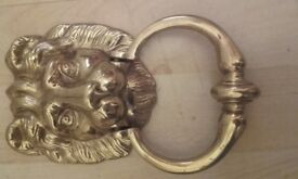 Brass lions head door knocker