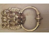 Brass lions head door knocker
