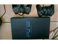 Playstation 2 with 28 games and two controllers PS2