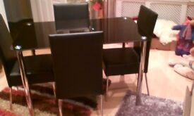 BLACK TEMPERED GLASS TABLE & FOUR CHAIRS IN PERFECT CONDITION.