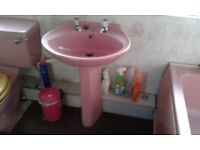 Pink bathroom suite. Pedastil ceramic sink. ceramic toilet