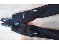 Black ski salopettes. Worn once. Suitable for teenage.