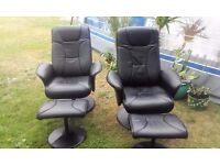 TWO FAUX LEATHER RECLINING SWIVEL ARMCHAIRS WITH FOOTSTOOLS