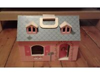 Wooden doll house in excellent condition