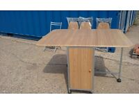 table and four chairs, this nearly new table with fold away chairs which fit inside the table