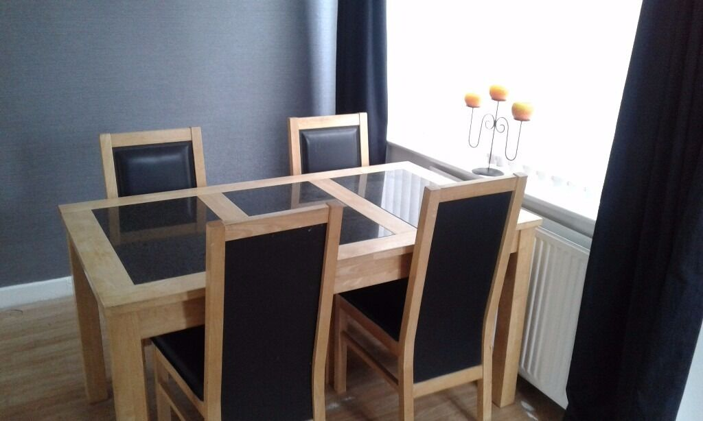 Dining table 4 chairsin Radcliffe, ManchesterGumtree - Dining table and 4 chairs solid marble inserts sadly my dog chewed one of the chairs see photo call me on 07873873295