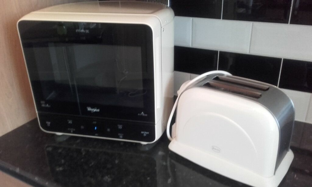 Cream whirlpool microwave and toaster