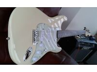 Fender Squier Stratocaster electric guitar in vintage white/cream.