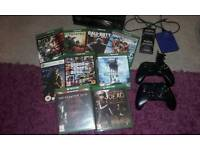 Xbox one,kinect,1tb hardrive,2controllers,9games and charging station and 2back packs
