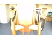 Oval table plus 4 high backed cream chairs ,table has curved legs