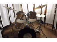 Retired drum teacher has a student drum kit with upgraded Paiste cymbals for sale.