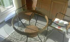 M&S ratten dinning room table and 4 chairs