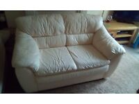 Cream leather 2 seater settee