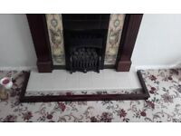 Gas fire with tiled surround