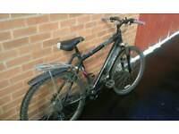 "Mountain bike 26"" wheels. Front suspension. Good working order"
