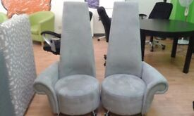 2 light grey high back chairs. Can be sold indivudally or as a pair. Hardly used.