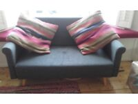 Grey two seater sofa. Comfy and very good condition