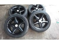 Vauxhall 4 stud black alloys 4x100 fitment. recently repainted tyres are bad one or two might do