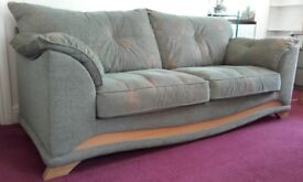3 seater sofa - janice green/jade green. Oak trim. Purchased at Bradbeers. Price includes delivery