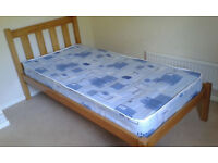 Single Bed by Julian Bowen Ltd. Wooden Frame with mattress. As near to new as you can get