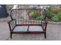 Two cottage style settees.