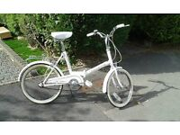 Fold up bike in full working order with a rack and a nice shade of brown