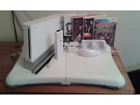 NINTENDO Wii. Wii Fit board. plus 6 games and accessories.