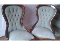 A pair of repro spoon back chairs