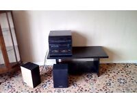 Three stack music centre with speakers and table