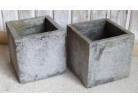 Two concrete garden pots